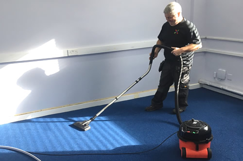 Worker cleaning floors